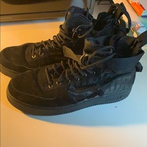Air Force ones high tops. All black